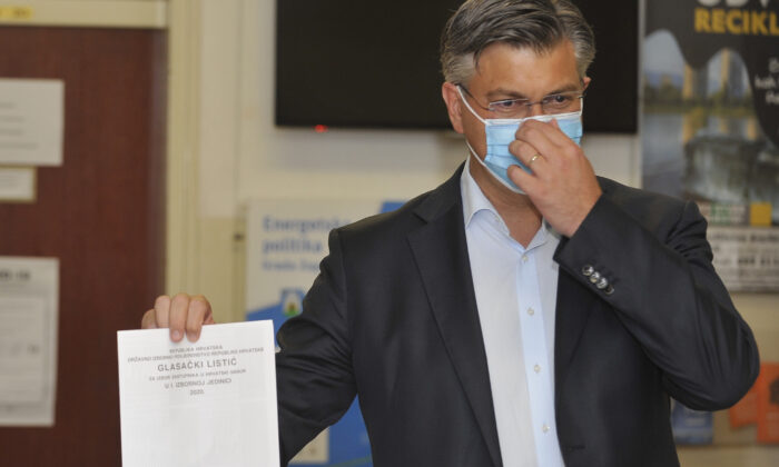 Andrej Plenkovic, Croatia's Prime Minister incumbent casts his ballot at a polling station in Zagreb, Croatia, on July 5, 2020. (AP Photo)