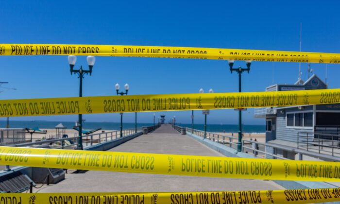 Police tape blocks the entry to the Seal Beach Pier in Seal Beach, Calif., on July 4, 2020. (John Fredricks/The Epoch Times)