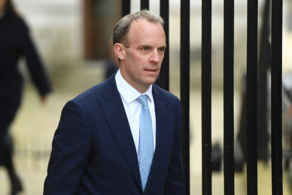 Britain's Foreign Secretary Dominic Raab arrives at 10 Downing Street on April 6, 2020 in London, England.