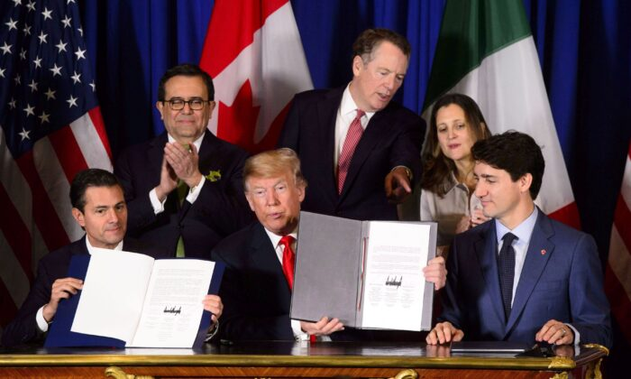(Clockwise from top L) Mexican Secretary of Economy Ildefonso Guajardo Villarreal, U.S. Trade Representative Robert Lighthizer, Foreign Affairs Minister Chrystia Freeland, Prime Minister Justin Trudeau, U.S. President Donald Trump, and Mexican President Pena Nieto participate in a signing ceremony for the United States-Mexico-Canada Agreement in Buenos Aires, Argentina, on Nov. 30, 2018. The new trade pact came into effect on July 1, 2020. (The Canadian Press/Sean Kilpatrick)