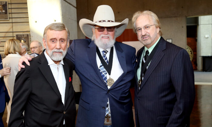 Charlie Daniels (center) in a file photo. (Terry Wyatt/Getty Images for Country Music Hall of Fame and Museum)