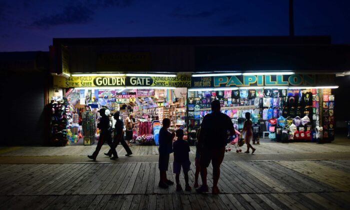 People shop and walk the boardwalk in Wildwood, N.J., on July 3, 2020. (Mark Makela/Getty Images)