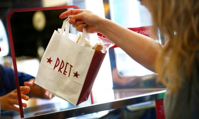 A bag is passed to a customer at Pret a Manger in New Cavendish Street, in London, Britain, on June 1, 2020. (Hannah McKay/Reuters)