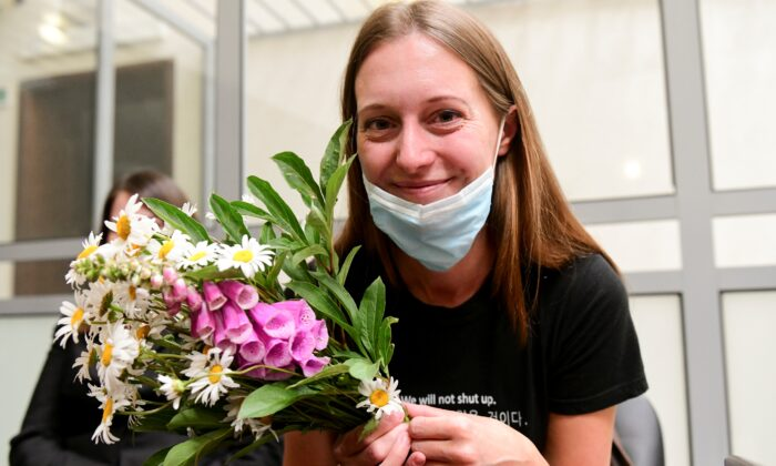 Russian journalist Svetlana Prokopyeva holds a bunch of flowers after a court session in Pskov, Russia, on July 6, 2020. (AP Photo)