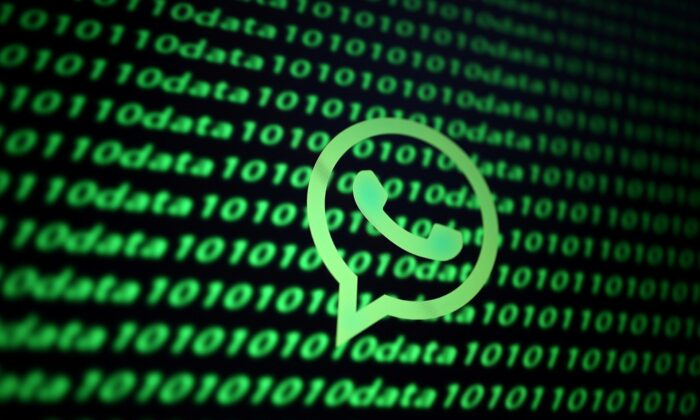 The Whatsapp logo and binary cyber codes are seen in this illustration taken on Nov. 26, 2019. (Dado Ruvic/Illustration/File Photo/Reuters)