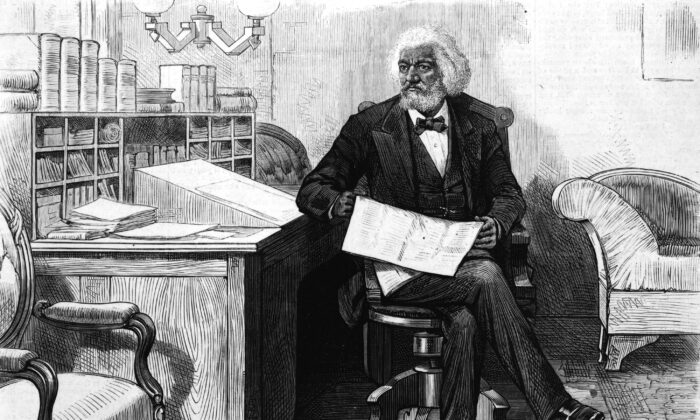 American orator, editor, author, abolitionist, and former slave Frederick Douglass (1818 - 1895) edits a journal at his desk in the late 1870s. (Hulton Archive/Getty Images)