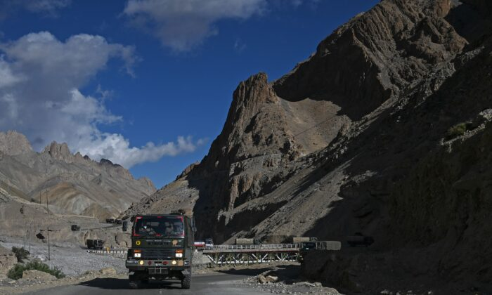 A military convoy drives towards Leh along the Srinagar-Leh Highway on June 29, 2020. (Tauseef Mustafa/AFP via Getty Images)