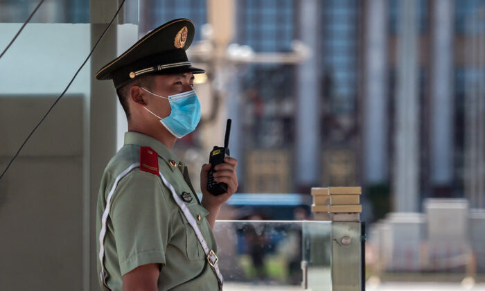 A paramilitary policeman stands guard on Tiananmen Square in Beijing on June 4, 2020. (Nicolas Asfouri/AFP via Getty Images)