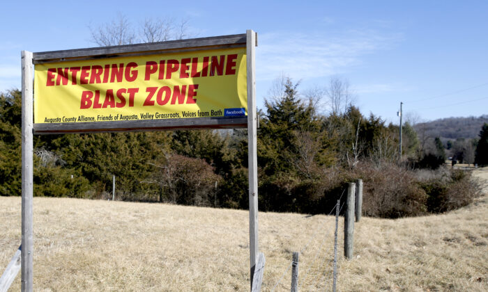 A sign along a highway protests the route of the Atlantic Coast Pipeline in Deerfield, Va., on Feb. 8, 2018. (Steve Helber/AP Photo)