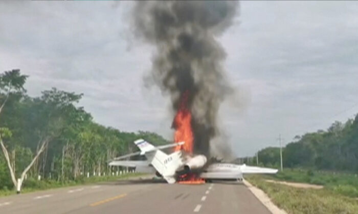 A plane suspected of carrying drugs was reportedly set alight after allegedly being intercepted by soldiers on Federal Highway 184 in Quintana Roo state, Mexico, according to local reports, July 5, 2020 in this still image taken from video. (via Reuters TV)
