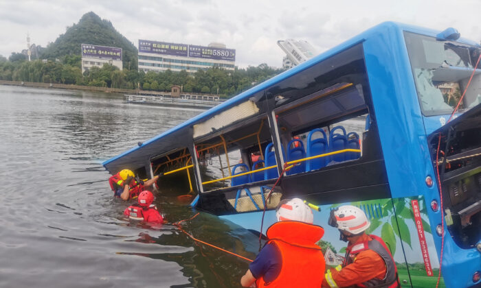 Rescue workers are seen at the site where a bus carrying students plunged into a reservoir, in Anshun, Guizhou province, China, on July 7, 2020. (China Daily via Reuters)