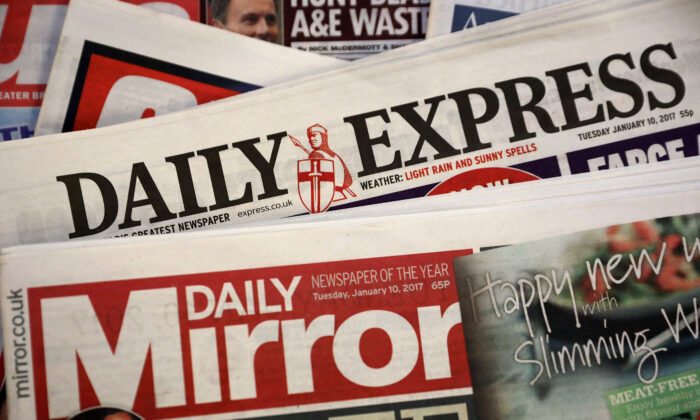 A photo illustration of British national newspapers The Daily Mirror and the Daily Express, in London, England, on Jan. 10, 2017. (Dan Kitwood/Getty Images)