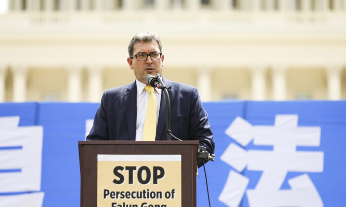 Benedict Rogers, a UK human rights activist, speaks at a rally commemorating the 20th anniversary of the persecution of Falun Gong in China, on the West lawn of Capitol Hill in Washington on July 18, 2019. (Samira Bouaou/The Epoch Times)