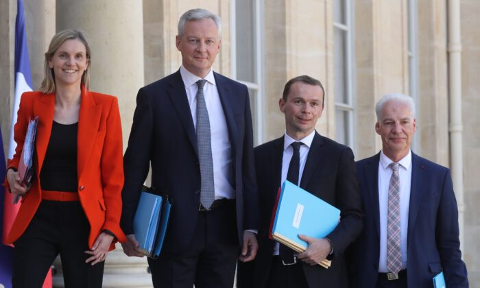 French Junior Industry Minister Agnes Pannier-Runacher, le French Economy and Finance Minister Bruno Le Maire, French Junior Minister of Public Action and Accounts Olivier Dussopt, and French Junior Minister of Small and Medium Entreprises Alain Griset arrive to attend the first weekly cabinet meeting after the government reshuffle, at the Elysee Palace in Paris, France, on July 7, 2020. (Ludovic Marin/AFP via Getty Images)