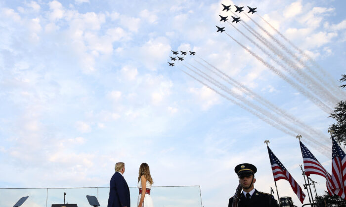 President Donald Trump and first lady Melania Trump watch the U.S. Navy Blue Angels and U.S. Air Force Thunderbirds perform a flyover near the White House in Washington on July 4, 2020. (Tasos Katopodis/Getty Images)