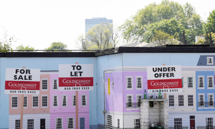 An estate agent property advertisement is seen painted on a wall in London, Britain, on May 15, 2019. (Toby Melville/Reuters)