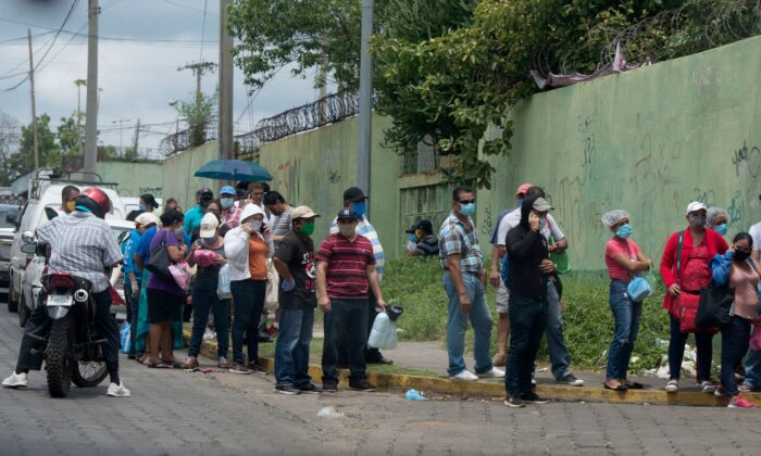 Relatives of patients wait in line to enter the Aleman-Nicaraguense Hospital which cares people infected with the novel Covid-19 coronavirus in Managua on June 1, 2020. (INTI OCON/AFP via Getty Images)
