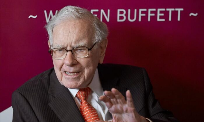Warren Buffett, Chairman and CEO of Berkshire Hathaway, speaks during a game of bridge following the annual Berkshire Hathaway shareholders meeting in Omaha, Neb., May 5, 2019. A new report is holding up legendary investor Buffett's decision to walk away from a proposed liquefied natural gas project in Quebec in March as one sign that the LNG sector in Canada and elsewhere is on shaky ground. (Nati Harnik/The Canadian Press via AP)