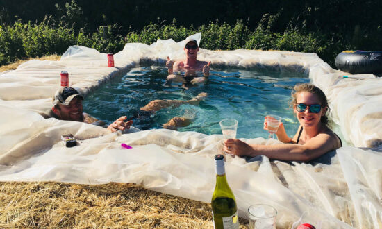 Family Build Makeshift Swimming Pool Out of Hay Bales in Backyard During Heatwave