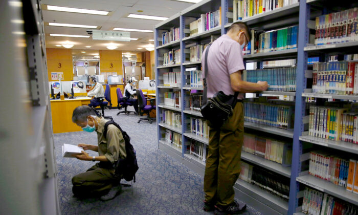 People read books at Hong Kong Central Library after democracy activists' books were taken down due to national security law in Hong Kong, on July 6, 2020. (Tyrone Siu/Reuters)
