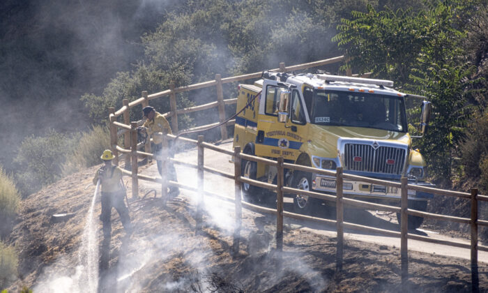 Emergency personnel are working through high temperatures to contain the Soledad fire in Agua Dulce, Calif., on July 6, 2020 (David Crane/The Orange County Register via AP)
