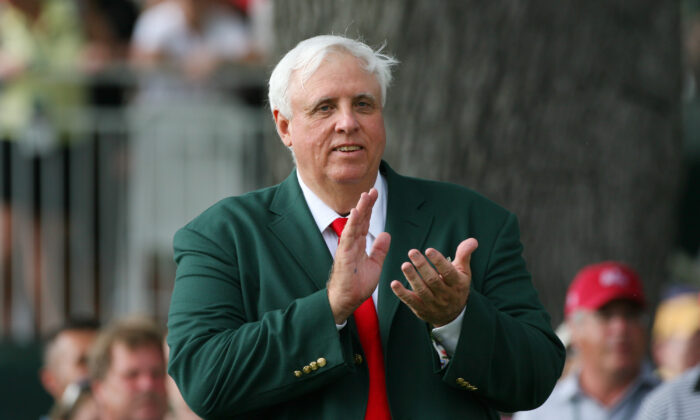 Jim Justice, owner of The Greenbrier Resort, applauds on the 18th tee during the final round of The Greenbrier Classic at The Old White TPC in White Sulphur Springs, W. Va.,  on July 31, 2011. (Hunter Martin/Getty Images)