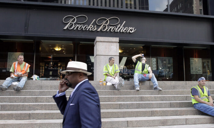 A man walks by a Brooks Brothers store on Church St. in New York, on Sept. 11, 2001. (Mark Lennihan/File/AP Photo)