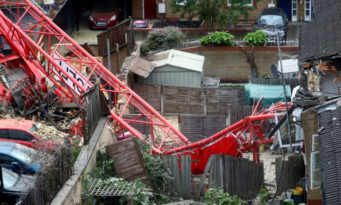 A collapsed crane is seen near a construction site in Bow, east London, Britain, on July 8, 2020. (Hannah McKay/Reuters)