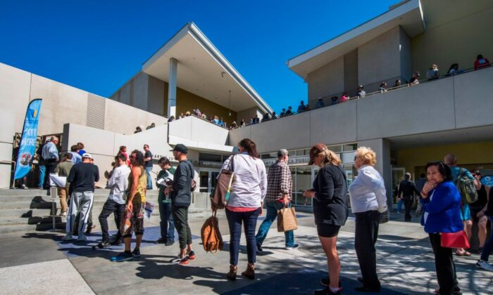 People wait to vote during the presidential primary at the Santa Monica Public Library in Santa Monica, Calif., on March 3, 2020. (Mark Ralston/AFP via Getty Images)