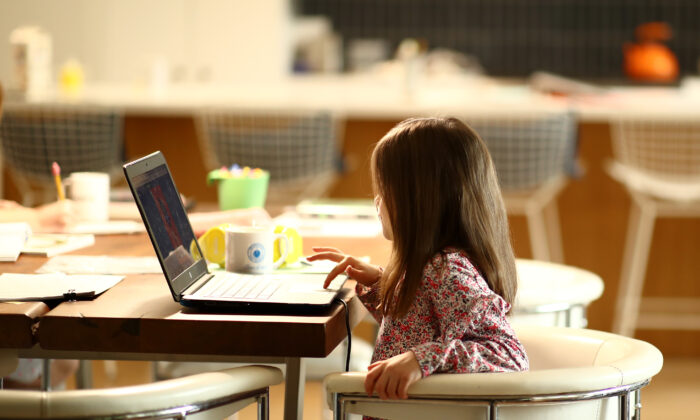 A kindergarten student does schoolwork at her home in San Anselmo, Calif., on March 18, 2020.   Ezra Shaw/Getty Images