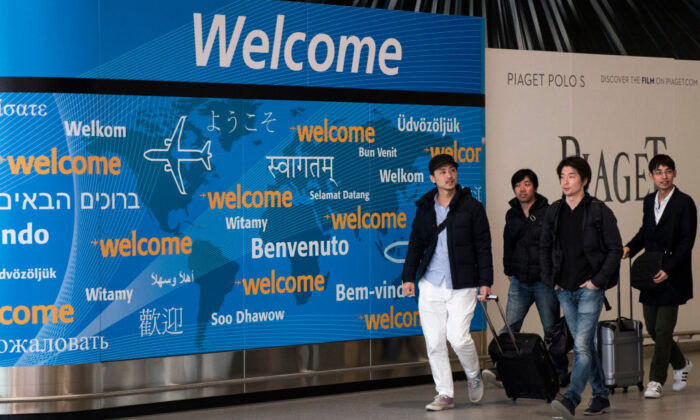 Travelers arrive at the international terminal at John F. Kennedy International Airport, in New York City, on March 6, 2017. (Drew Angerer/Getty Images)