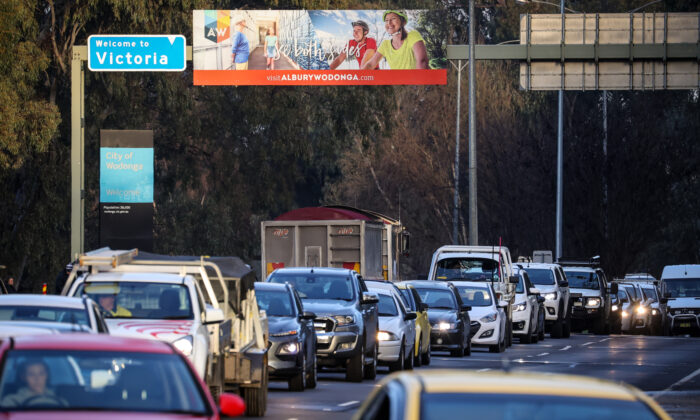 Cars queue at the Victorian border near a police checkpoint in Albury, Australia on July 8, 2020. (David Gray/Getty Images)