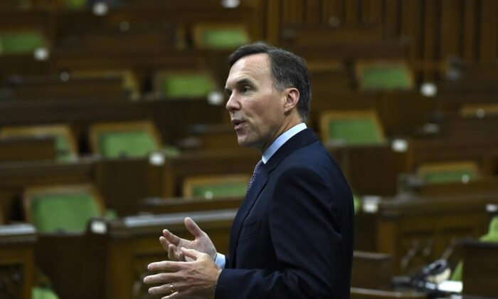 Finance Minister Bill Morneau rises during a meeting of the Special Committee on the COVID-19 pandemic in the House of Commons on Parliament Hill in Ottawa, on June 17, 2020. (Justin Tang/The Canadian Press)
