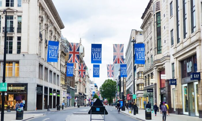 Thank You banners and Union Jack flags are seen hanging across Oxford Street as tribute to the NHS workers during the CCP virus pandemic, in London, England, on June 4, 2020. (Lily Zhou/Epoch Times)