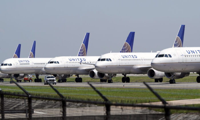United Airlines planes are parked at George Bush Intercontinental Airport in Houston, Texas, on March 25, 2020. (David J. Phillip/AP)