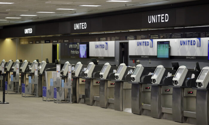 Empty United Airlines ticket machines are shown at the Tampa International Airport in Tampa, Fla., on April 24, 2020 (Chris O'Meara/AP Photo)