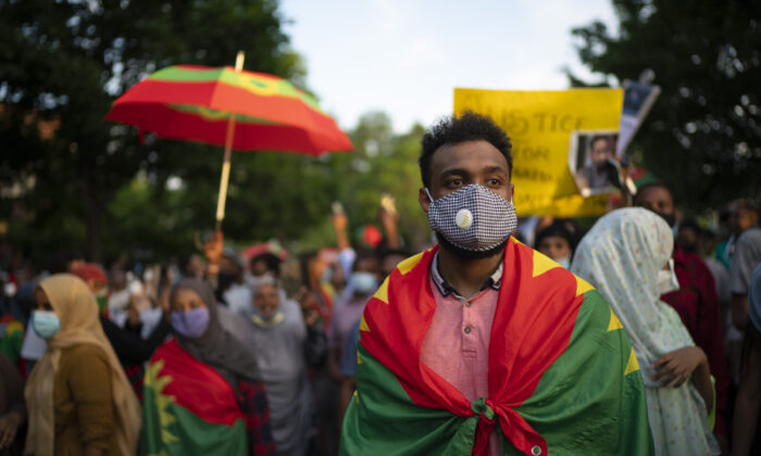 Protesters outraged by the killing of popular Ethiopian singer Hachalu Hundessa walk along Lexington Avenue after exiting off westbound Interstate 94, in St. Paul, Minn., on July 1, 2020. (Jeff Wheeler/Star Tribune via AP/File)