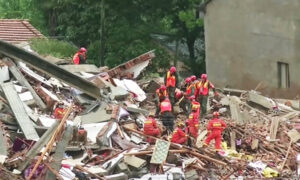 Landslide Buries 9 in Central China as Country Suffers Worst Floods in Years