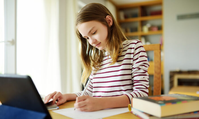 According to a USA Today/Ipsospoll, 60 percent of parents surveyed said they will likely choose at-home learning this fall rather than send their children to school even if the schools reopen for in-person learning. (MNStudio/Shutterstock)
