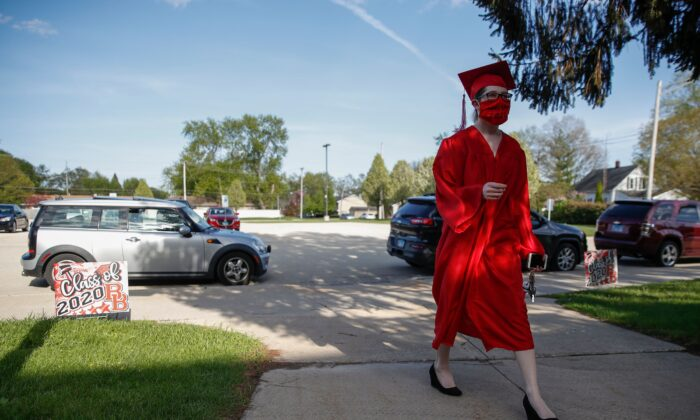 A graduate student arrives to pick up her diploma at Bradley-Bourbonnais Community High School on May 6, 2020 in Bradley, Ill. (Kamil Krzaczynski/AFP via Getty Images)