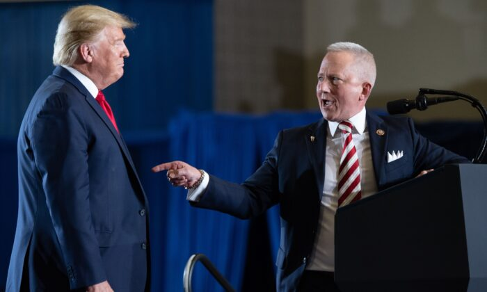 """Rep. Jeff Van Drew (R-N.J.), who recently switched parties, gestures toward President Donald Trump during a """"Keep America Great"""" campaign rally at Wildwoods Convention Center in Wildwood, N.J., on Jan. 28, 2020. (Saul Loeb/AFP via Getty Images)"""