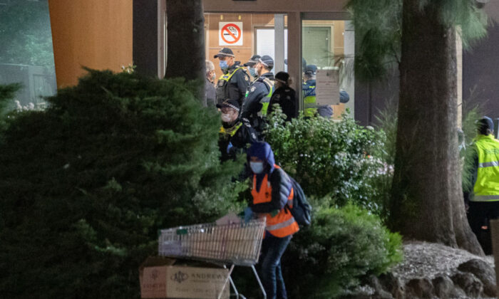 Police are seen in the foyer of the public housing flat at 33 Alfred Street in North Melbourne, which had 53 confirmed cases—about 11 percent of all residents in that tower on July 9, 2020 in Melbourne, Australia. (Asanka Ratnayake/Getty Images)