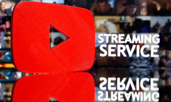 """A 3D-printed YouTube logo is seen in front of displayed """"Streaming service"""" words in this illustration taken March 24, 2020. (Dado Ruvic/Reuters)"""