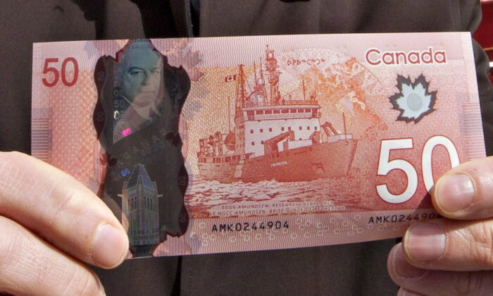 The new polymer $50 bill is pictured on March 26, 2012, the date it went into circulation. (THE CANADIAN PRESS/Jacques Boissinot)