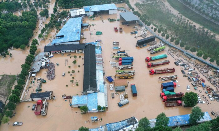 Inundated buildings and vehicles after heavy rain caused flooding in Shexian county, Huangshan city, in eastern China's Anhui province on July 7, 2020. (STR/AFP via Getty Images)