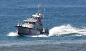 Coast Guard Rescues 5 People and Dog From Half-Submerged 52-Footer Near Great Lake Huron