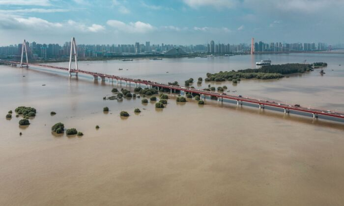 Streets inundated by floodwaters from the swollen Yangtze River following seasonal rains in Wuhan, China on July 8, 2020. (STR/AFP via Getty Images)