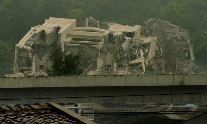 Chinese authorities continue the demolition, started a couple of days earlier, of a Christian church in Oubei town, outside of Wenzhou city, China, on April 30, 2014. (Mark Ralston/AFP via Getty Images)