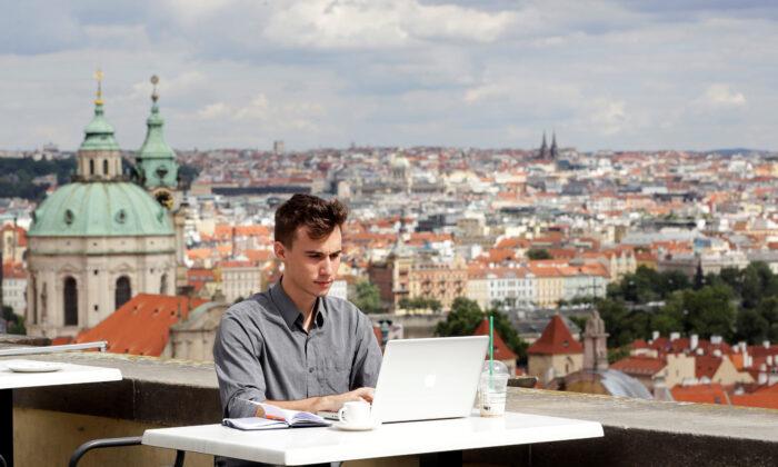 Joseph Petrila, a 23 years old job seeker, uses a laptop in a cafe near the Prague Castle following the coronavirus disease (COVID-19) outbreak, in Prague, Czech Republic, on July 8, 2020. (David W Cerny/Reuters)