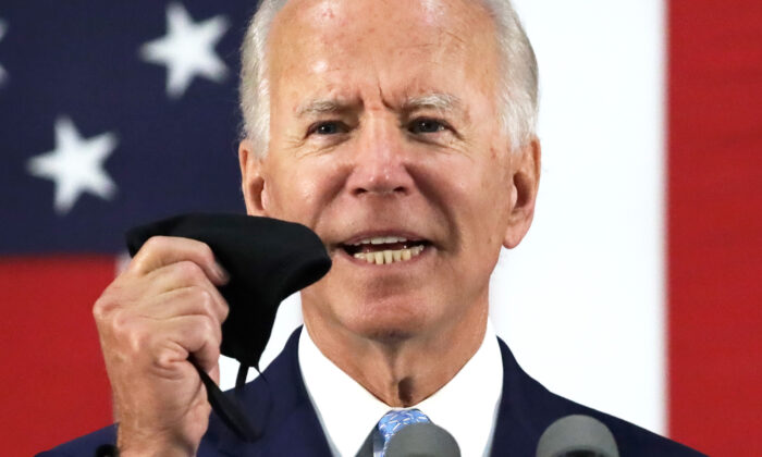 Democratic presidential candidate and former Vice President Joe Biden holds up a mask as he speaks during a campaign event in Wilmington, Del., on June 30, 2020. (Alex Wong/Getty Images)